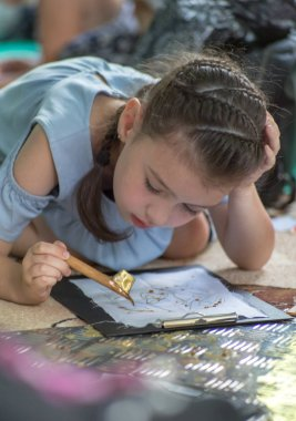 Moscow, Russia - August 03, a 2018:master-class for children and adults at the third Festival of Indonesia in the park Krasnaya Presnya