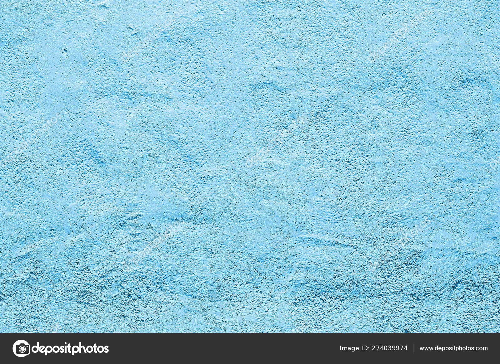 The wall plaster painted blue color textured