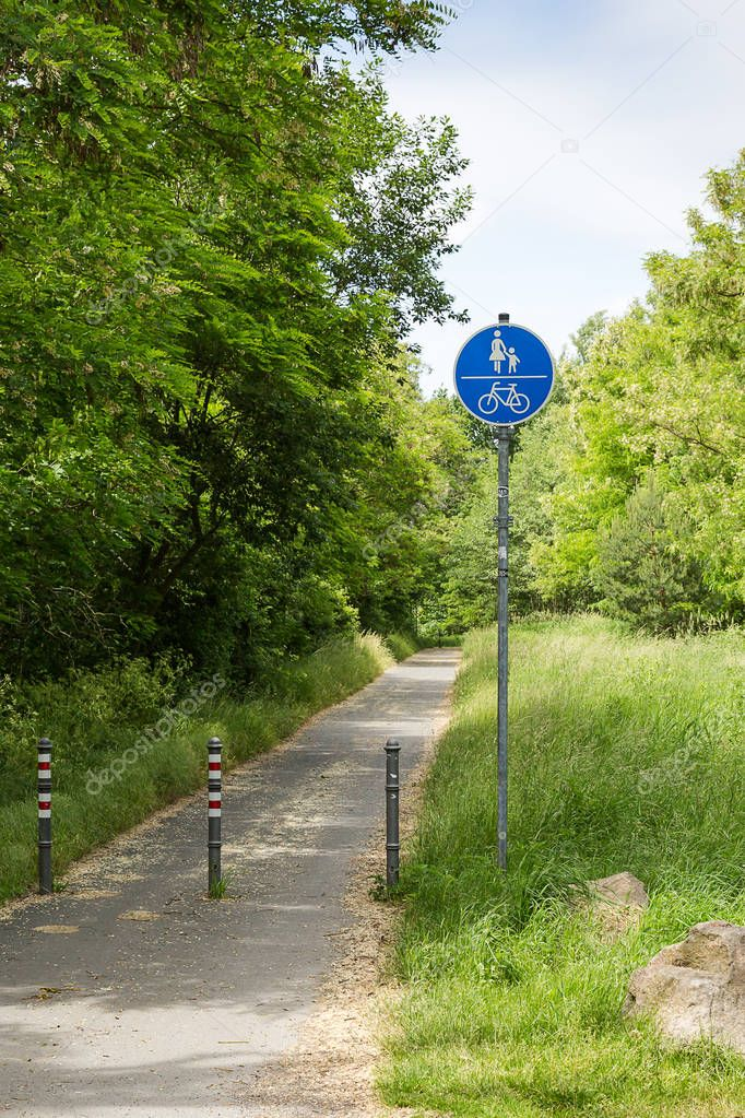 start of a cycle path with traffic signs and bollards in Saxony, Germany