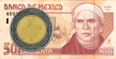 1 mexigan peso coin against 50 mexican peso bank note