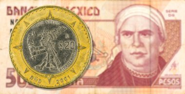 20 mexican peso coin against 50 mexican peso bank note obverse