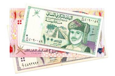 heap of omani rial bank notes