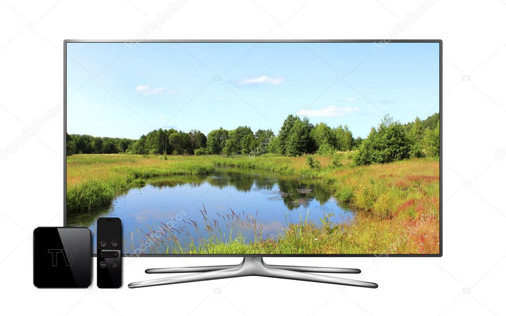 Smart tv and multimedia box with remote controller and landscape wallpaper on screen. Isolated on white background.
