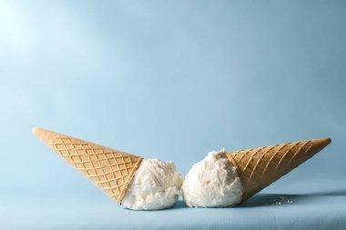 sweet white ice creams on pastel blue background