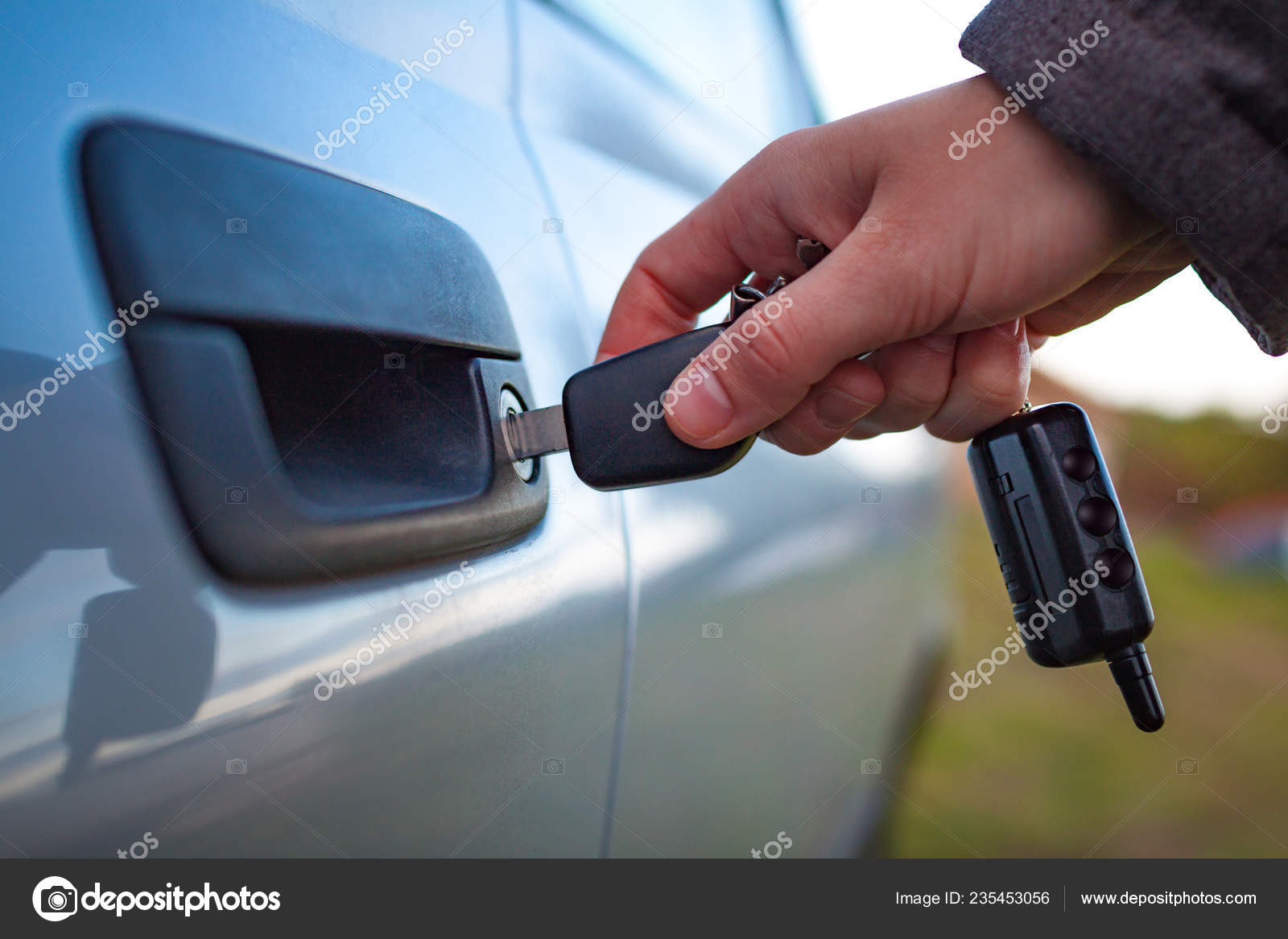 Male Hand Unlocking Car Door Key — Stock Photo © goffkein