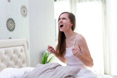 Angry screaming woman suffering and disturbed from noisy neighbo