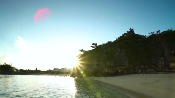 Video of sunrise landscape of the Shinto Shrine Naminoue at the top of a cliff overlooking the beach and ocean of Naha in Okinawa Prefecture, Japan.