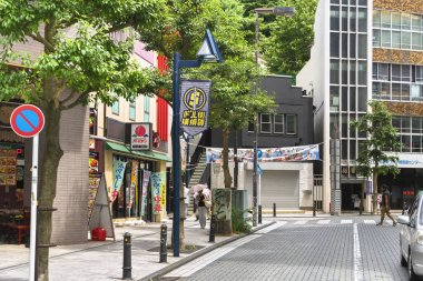 yokosuka, japan - july 19 2020: Dobuita Shopping Street famous among young sailors of Yokosuka Naval Base decorated with flags celebrating the street as the one where US dollars can be used.