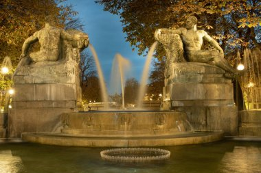 Turin, Piedmont, Italy - Fontana Angelica is an historical fountain of Turin, designed by Giovanni Riva and located in Piazza Solferino (Solferino Square). Represents the four seasons: two female figures (representing Spring and Summer) and two male