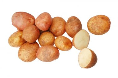 A lot of raw potatoes on a white isolated background