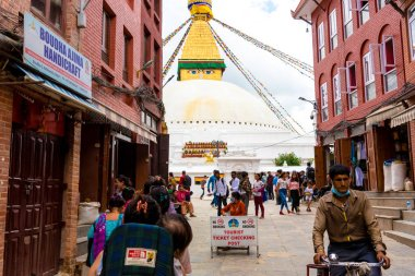 Kathmandu, Nepal - July 15, 2018 : Street view at Boudhanath ( Boudha ) Stupa complex, a UNESCO heritage site and an important place of pilgrimage and worship for Buddhists all over the world.