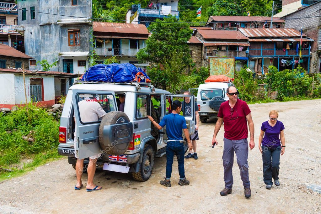 Annapurna Conservation Area, Nepal - July 18, 2018 : Off road vehicles with tourists in Annapurna Conservation Area, a hotspot destination for mountaineers and Nepal's largest protected area.