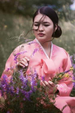 Korean girl in national dress in the spring photo forest