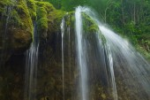 beautiful waterfall landscape on granite stones. fast water flow with blur effect