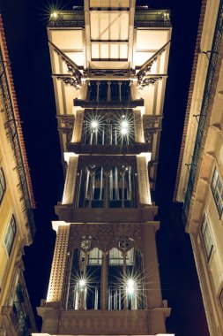Rear view of elevator Elevador de Santa Justa in Lisbon at night time. Portuguals capital with the historic lift in the city center. Elevator with lighting