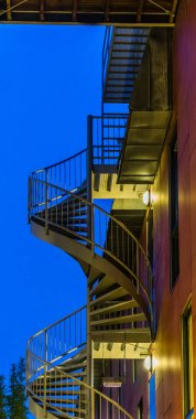 spiral staircase of a modern building, lighted at night, modern city architecture