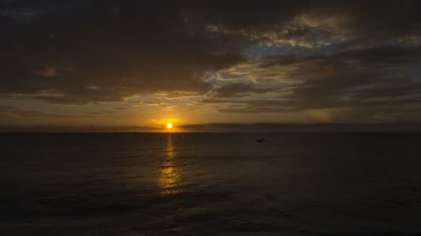 Amazing time-lapse of the sunset on the cloudy sky in Caribbean