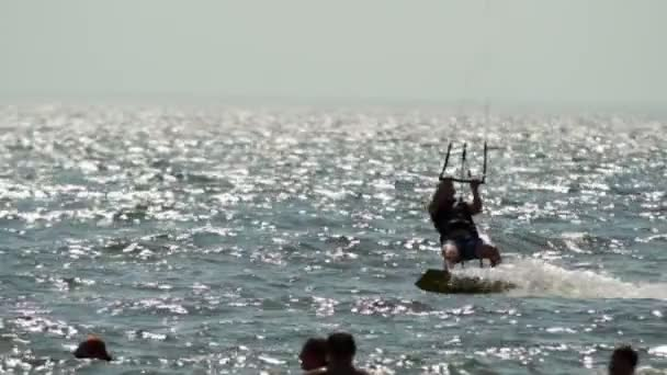 Silhouette kitesurfer on lake. Slow-mo