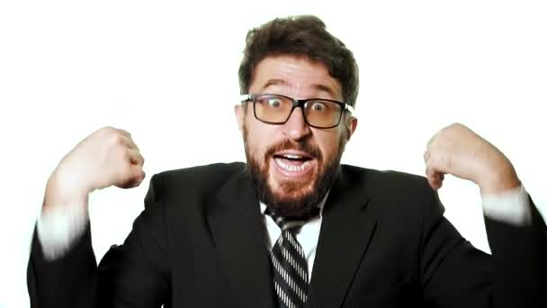 Bearded businessman wearing glasses and a suit on a white background.