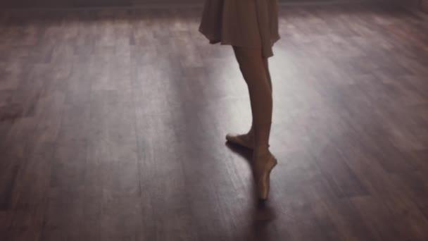 Ballerinas legs in pointe shoes. Ballerina is standing on tiptoe. Ballet dance.