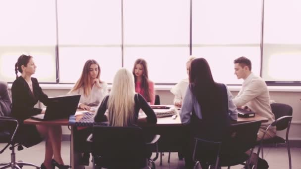 Women working together project. Female entrepreneurship. Adult business woman leads a team of young girls. Business friends discussing brainstorming and ideas. Group of female coworkers and one men.