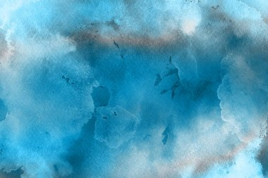 blue watercolor paint on paper abstract background
