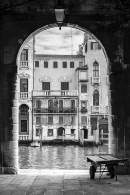 Grand Canal typical palace facades viewed from the fish market with an arch and a wheelbarrow, Venice, Italy