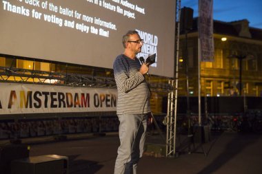 Amsterdam, The Netherlands - August 24 2016: presentation of festival director Raymond Walravens at open air screening of Argentine film Road to la Paz at Marie Heinekenplein, during World Cinema Amsterdam, a world film festival held from 18 to 27/08