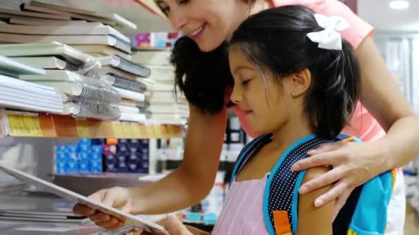 mother and sister in sstore preparing back to school