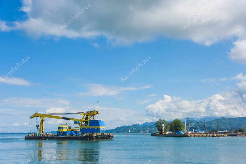 Port in Batumi. Large water crane for lifting loads. Rest in Georgia. Floating crane in the port.