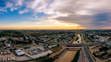 Panorama of the industrial part of the city of Shymkent. Sunset over the city of Shymkent. Surroundings of the Turkestan region