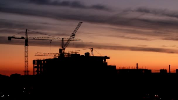 Construction of high-rise building against on the background of sunrise, time lapse