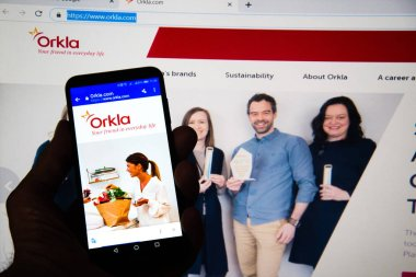 Chicago, California, USA - March 26, 2019: Orkla homepage on a smartphone and computer screen.