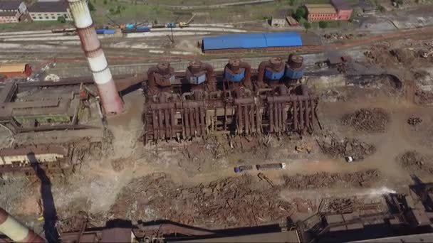Chelyabinsk region, Russia. July 2020: The destruction of the old factory. Aerial shot: workers dismantle the old metallurgical plant. Change of ownership of an industrial enterprise. Huge metal