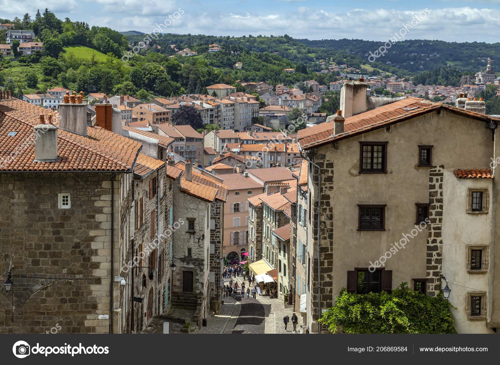 Architecte Le Puy En Velay puy velay france nun walking colorful back street city puy