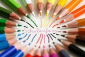 many colorful pens in several arrangements with school enrollment as an inscription in german