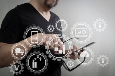 Smart factory and industry 4.0 and connected production robots exchanging data with internet of things (IoT) with cloud computing technology.Designer hand with eyeglass using smart phone for mobile payments online.