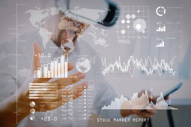 Investor analyzing stock market report and financial dashboard with business intelligence (BI), with key performance indicators (KPI).businessman wearing virtual reality goggles in modern office.