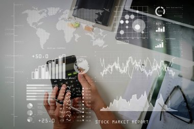 Investor analyzing stock market report and financial dashboard with business intelligence (BI), with key performance indicators (KPI).businessman hand working with finances about cost and calculator.