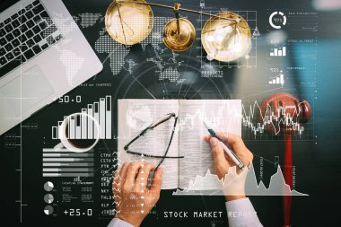 Investor analyzing stock market report and financial dashboard with business intelligence (BI), with key performance indicators (KPI).justice and law concept.Top view of Male judge hand in a courtroom.