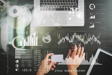 Investor analyzing stock market report and financial dashboard with business intelligence (BI), with key performance indicators (KPI).Internet shopping concept.Top view of hands working with calculator and laptop.