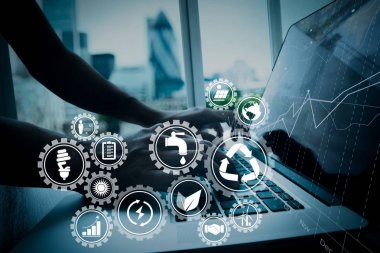 Sustainable development with icons of renewable energy and natural resources preservation with environment protection inside connected gears.business man hand working on laptop computer.