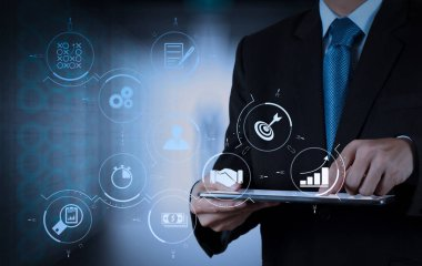 Business process management with workflow automation diagram and gears in virtual flowchart.businessman success working computer touch screen with his team as concept