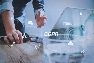 GDPR. Data Protection Regulation with Cyber security and privacy virtual diagram.Man using VOIP headset with digital tablet computer docking smart keyboard, concept communication, it support.