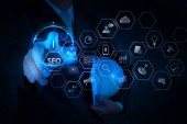 Seo Optimization for website with mobile website and Landing page virtual diagram.engineer pushing start button on touch screen computer interface