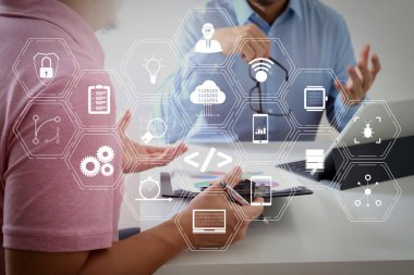 Coding software developer work with augmented reality dashboard computer icons of scrum agile development and code fork and versioning with responsive cybersecurity.Businessmen working together on a document.