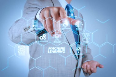 Machine learning technology diagram with artificial intelligence (AI),neural network,automation,data mining in VR screen.Businessman hand pressing an imaginary button on virtual screen