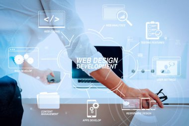 Developing programming and coding technologies with Website design in virtual diagram.Big data analytics with business intelligence (BI) concept.Businessman working in modern office with VR chart and graph with icon