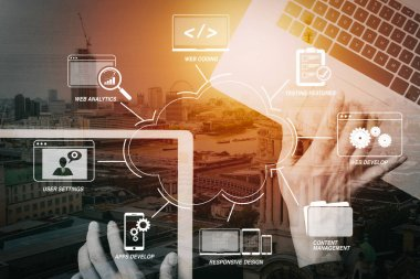 Developing programming and coding technologies with Website design in virtual diagram.cyber security internet and networking concept.Businessman hand working with  laptop computer and digital tablet background.