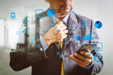 Financial report data of business operations (balance sheet and income statement and diagram) as Fintech concept.success businessman holding tie and using smart phone and thinking